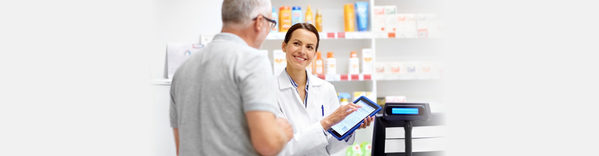 pharmacist holding a tablet