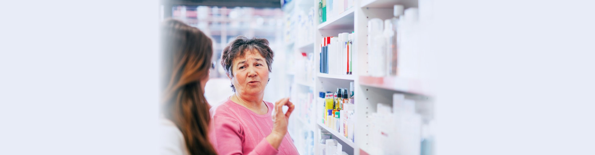 senior buying some medicines