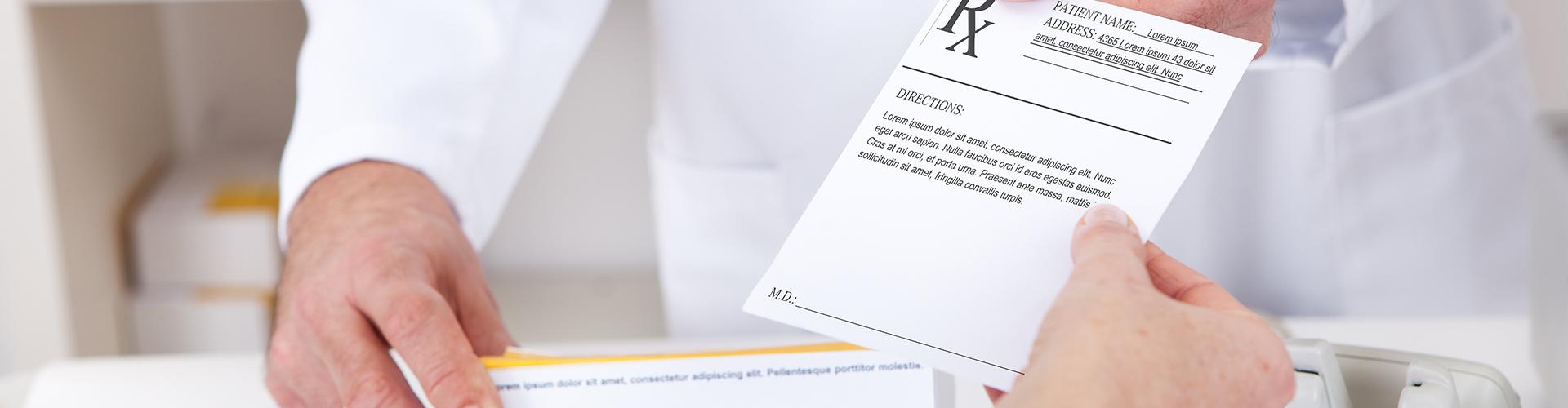 customer hands prescription to pharmacist